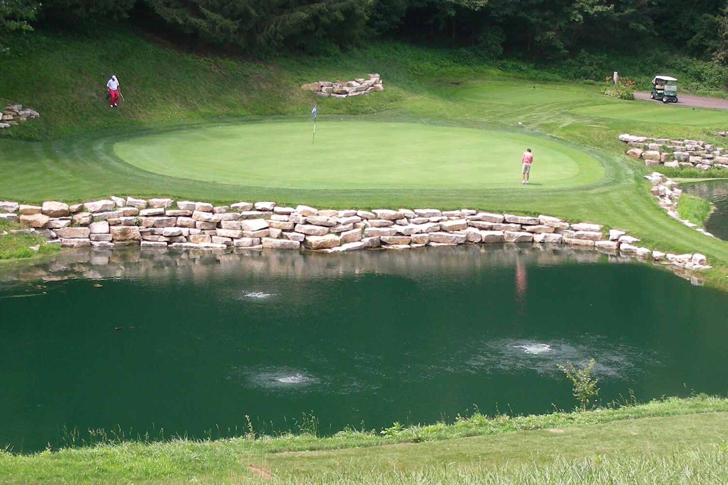 An Otterbine Aerating Fountain Otterbine with Air Flo Diffused Aeration at a golf course