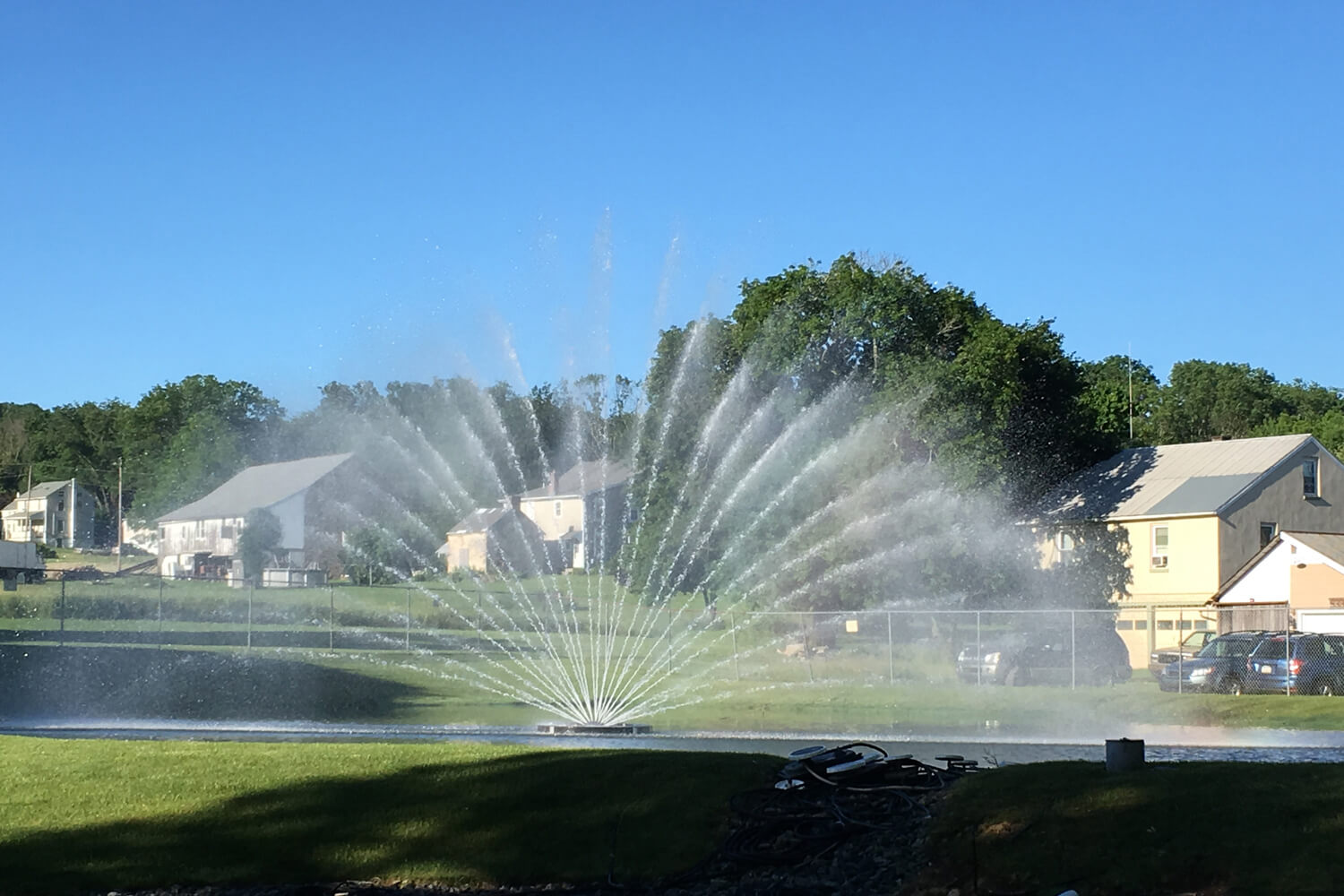 One of Otterbine's Aries Aerating Fountains in a residential area