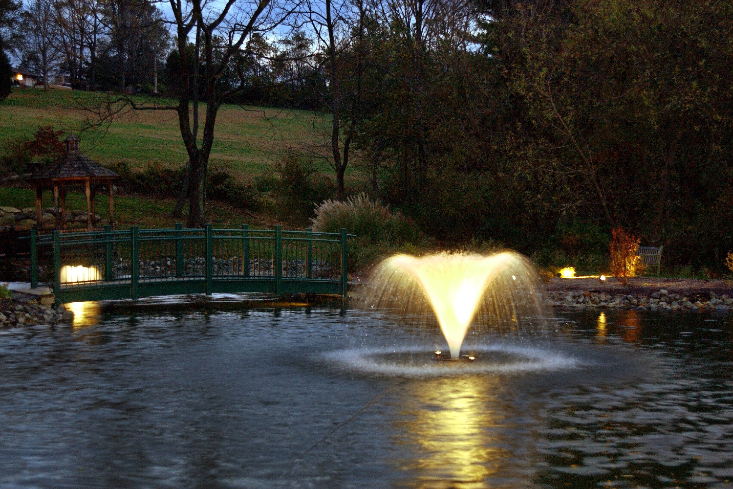 One of Otterbine's Aerating Fountains in a beautiful park at night