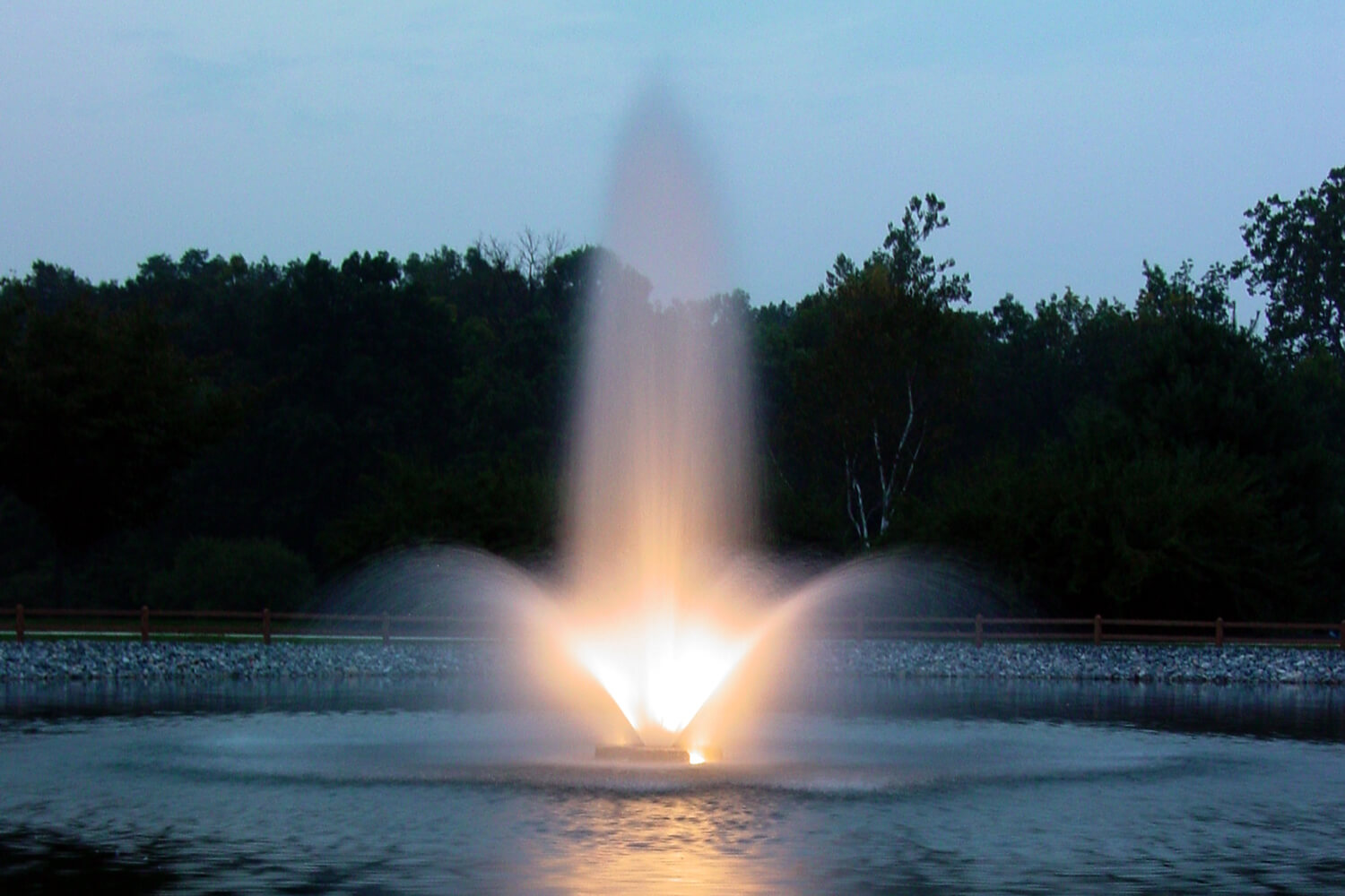 One of Otterbine's Aerating Fountains with Fountain Glo™ LED Low Voltage Lighting